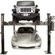 FREE SHIPPING — Dannmar 4-Post Car Lift — 7000-Lb. Capacity, 70 1/2in. Max Rise, Model# Commander 7000 The price is $2,415.00.